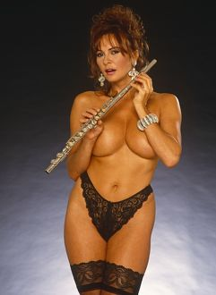 Donna Ewin topless holding a flute