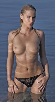 Girl topless outdoors