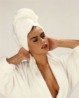 Girl in white towelling robe and turban