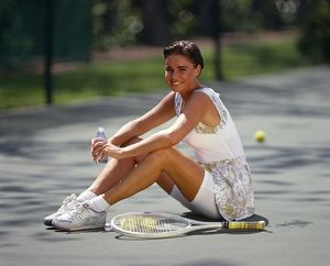 Girl sitting on tennis court